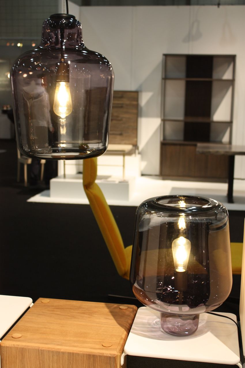 "A number of designers from Norway were featured in the ""Inside Norway"" booth at ICFF 2016 in New York. Oslo-based Northern Lighting created this lovely lamp, called ""Say My Name."" While the mouth-blown piece is made in Italy of Venetian glass, the design is Nordic, created by Morten & Jonas. Its smooth surface and unembellished form is distinctly contemporary Scandinavian style. The colors of glass reflect are meant to evoke the Nordic night sky, light of the fjords and smooth surface of calm water. It can be used as a table lamp or hung as a pendant."