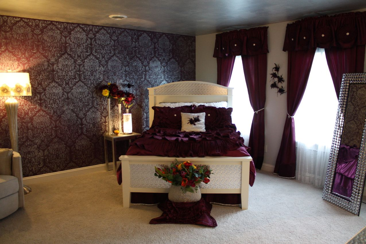 Decorative Artist Pamela Quick gave this girl's bedroom a romantic look with a touch of bling with her purple and silver scheme. The walls shine with a silver Florentine damask stencil. The bedding, drapery and accessories all sparkle with rhinestones, which highlight the deep, rich purple.