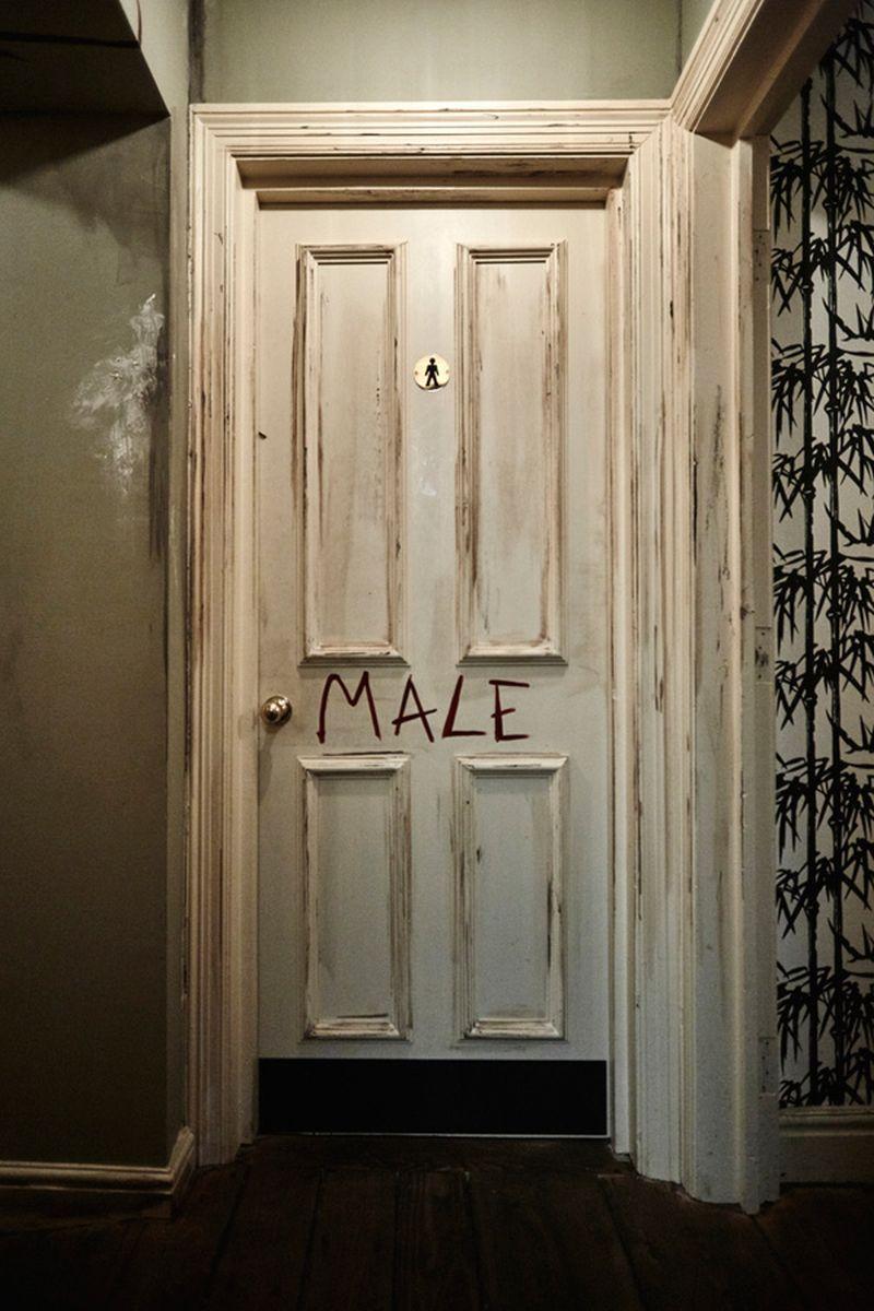 Red's True Barbecue bathroom door