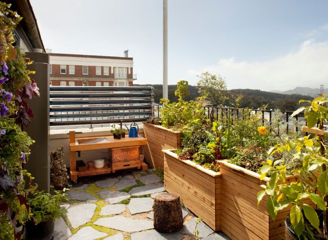 Use wooden planters to make a balcony look more inviting and comfortable