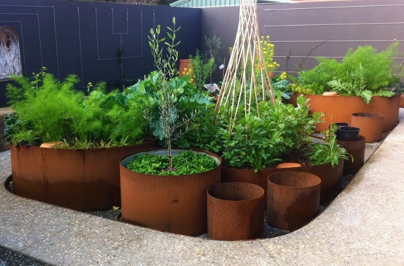 Choose a type of metal with a color that complements the plants you want to put in the container