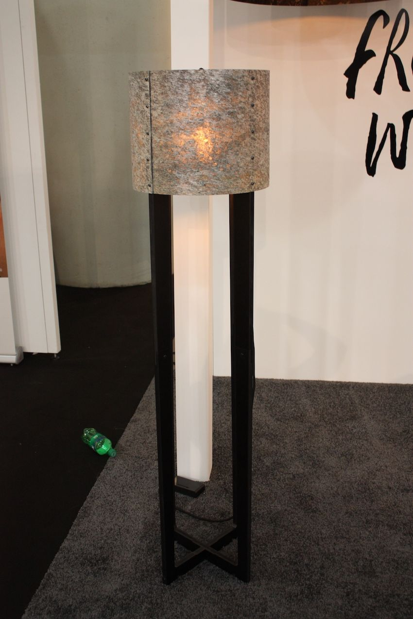 In a more traditional style with a rustic fiber shade, this wooden floor lamp would work in just about any space thanks to the neutral shade and versatile base.