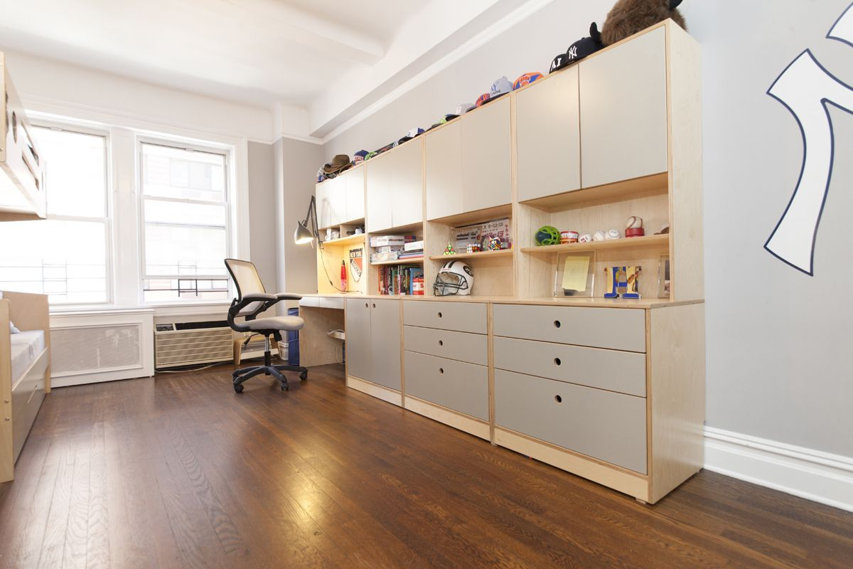 Even in a spacious room, compact functional furniture can leave plenty of open space for play. This wall unit with built-in desk across from the bed module is basic but definitely not boring.