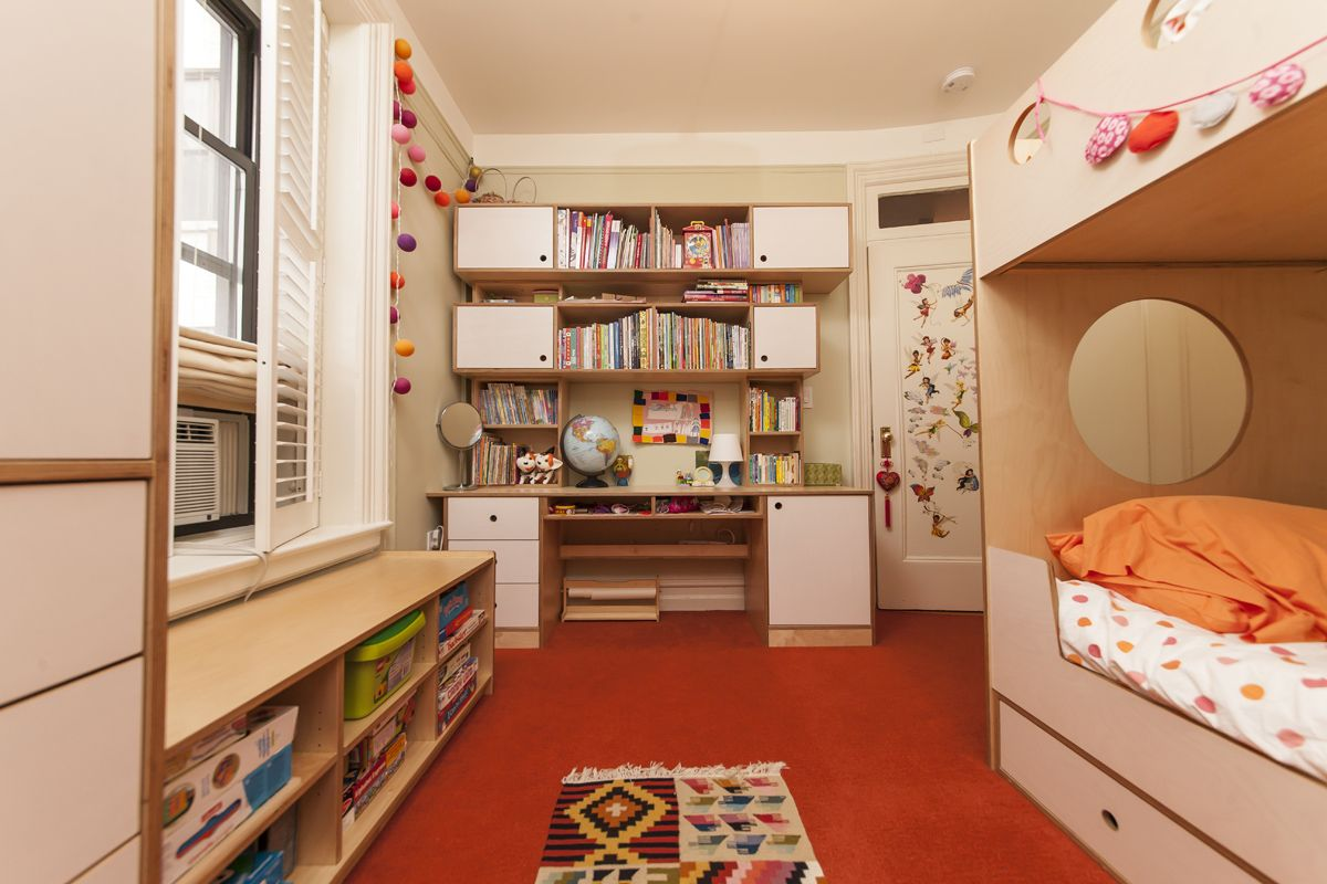 This rooms designed for two little girls whose small room is also used for family storage. The Marino Bunk Bed with Ladder maximizes the space.with storage drawers underneath for even more storage. The colorful rug and decor add fin and pop to the design.