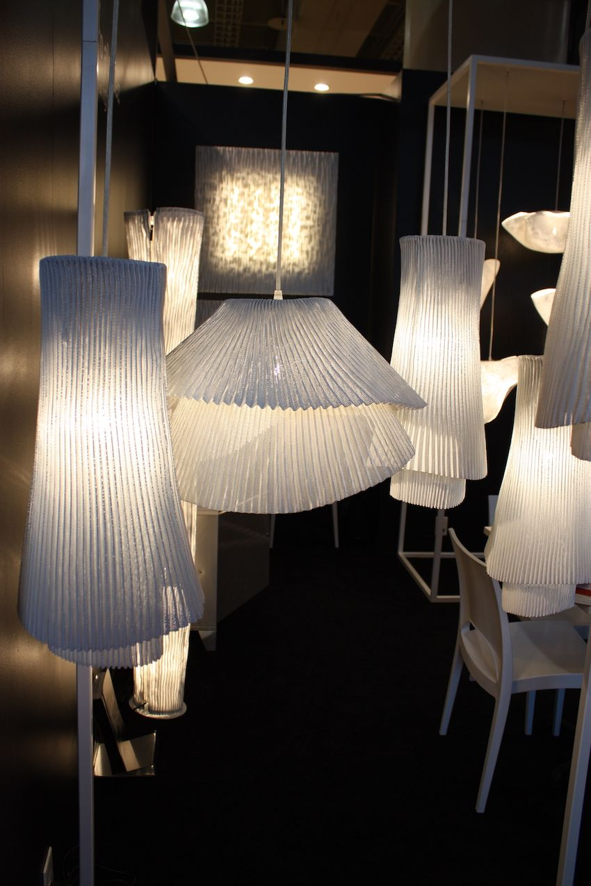 These pleated fixtures are from his Tempo Collection, which is made from painted stainless steel mesh. Folded into fine pleats, the designer uses two overlapped layers to create dynamic pendants.