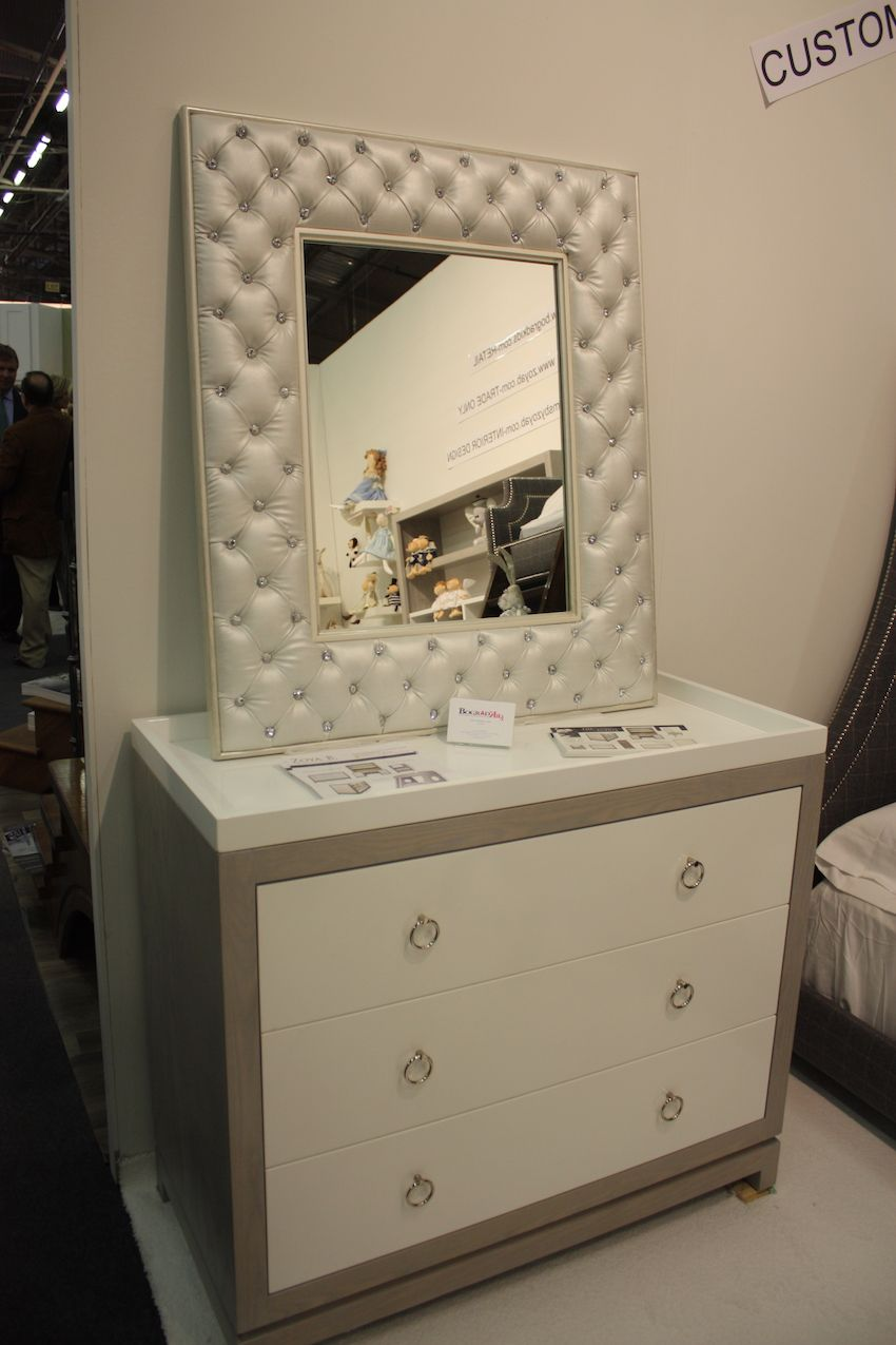 Zoya's furniture is not all painted and gilded. She also has created a range of modern, clean-lined and child-friendly. This Tempo Dresser/Changer in Gray Ash is paired with the Crystal Tufted Mirror in Gustavian White. Stunning.