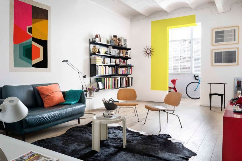 Colorful Apartment With A White Backdrop And Eclectic Artwork