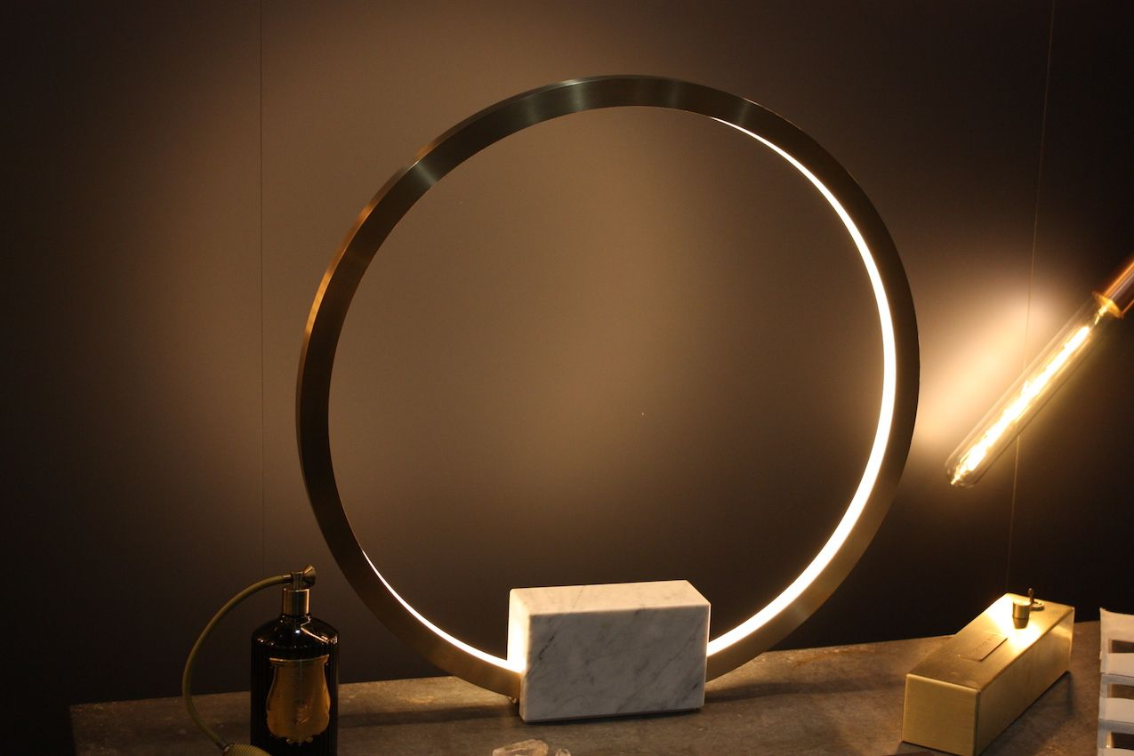 The Portal is a modern table lamp that truly makes you feel as if it's possible to pass through it to another dimension. Presented by Christopher Boots, the brass fixture is also made with gallium, polymer and carrara marble. It is available in two sizes.