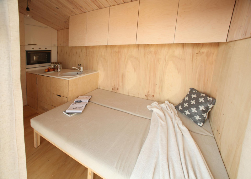 Tiny vacation home on wheels bed