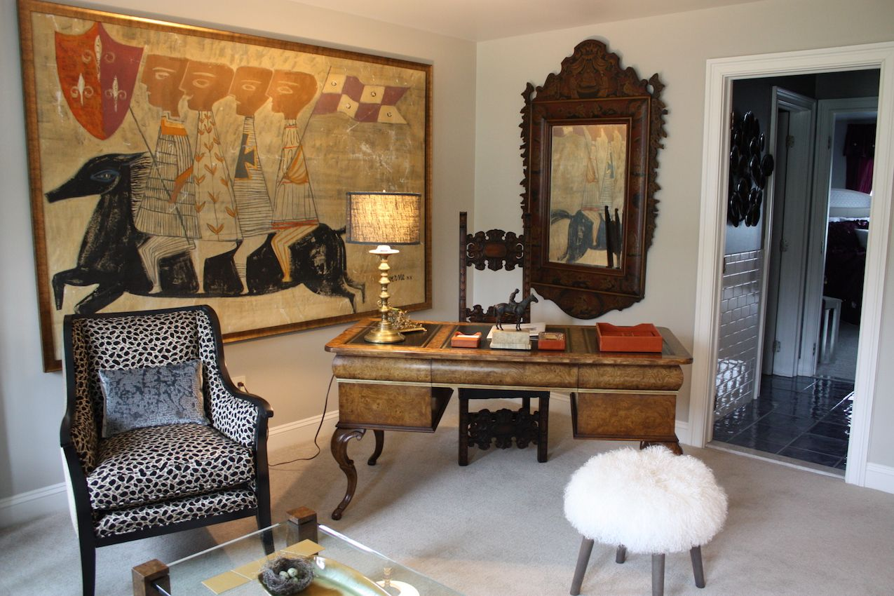 Originally the homeowner's son's bedroom, this room was transformed by Cross River Inc. and Trojan Horse Antiques into a second-floor sitting room. The antiques are elegant and mix well with the more modern elements like the furry stool and animal print chair.