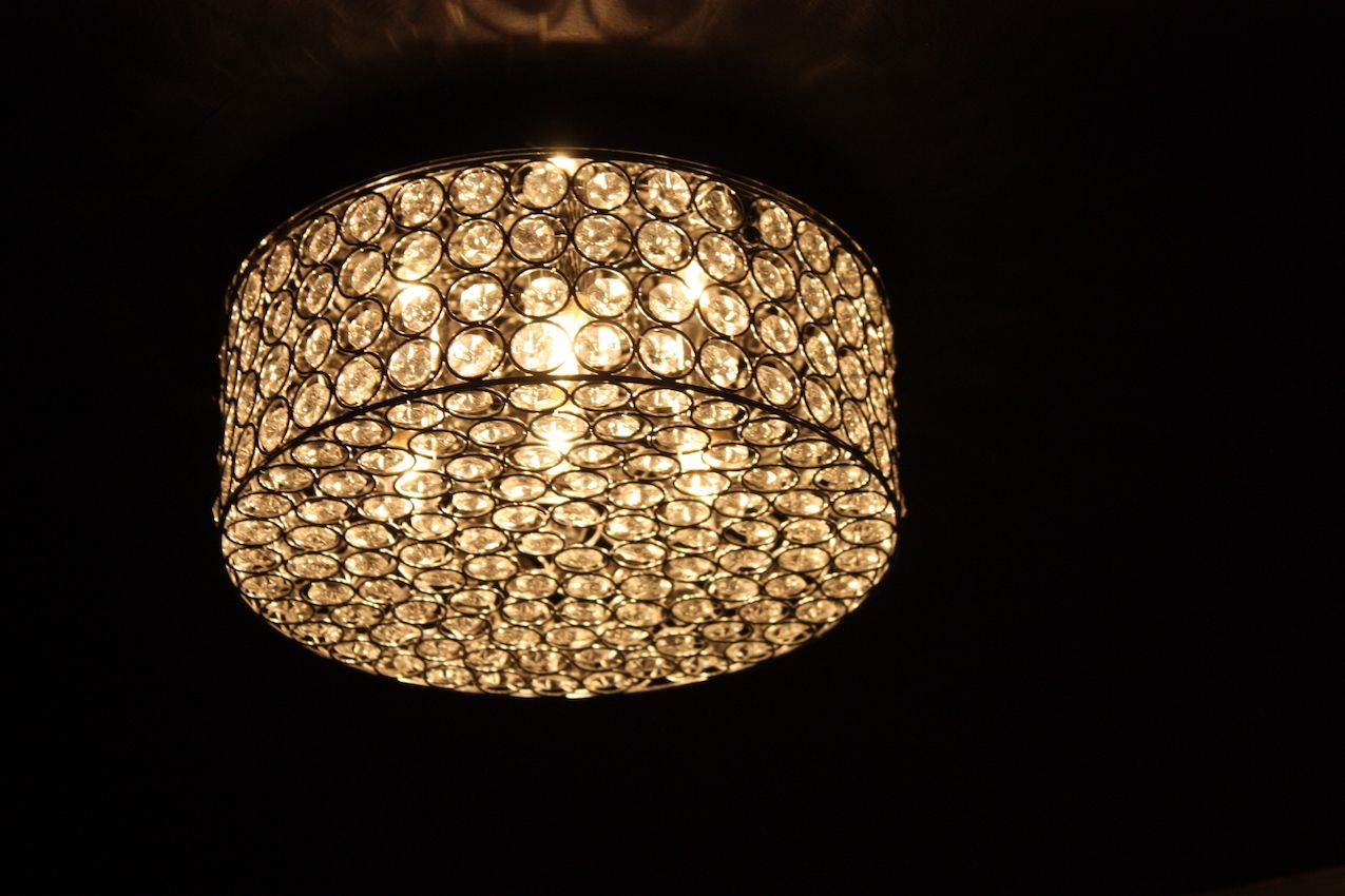 The ceiling light also sports the same crystals that the vanity light fixture has.