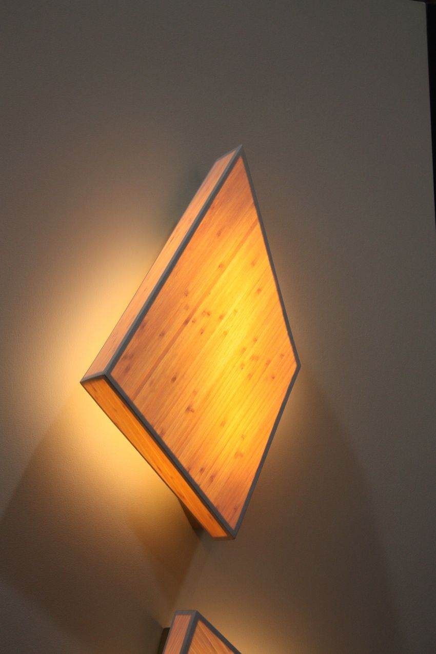 The Diamond Series is fashioned from a translucent wood envelope over a brass mounting box.