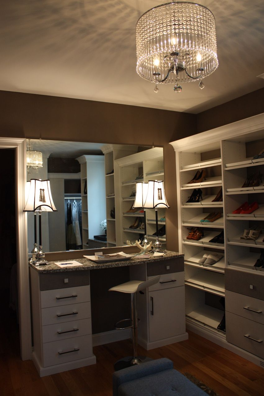 A well-lit vanity perfect for primping hair and make-up is a built in part of this grand closet.