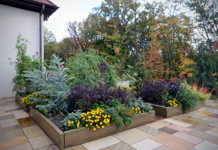 Wooden garden planters and flower beds help protect plants from heat and sun