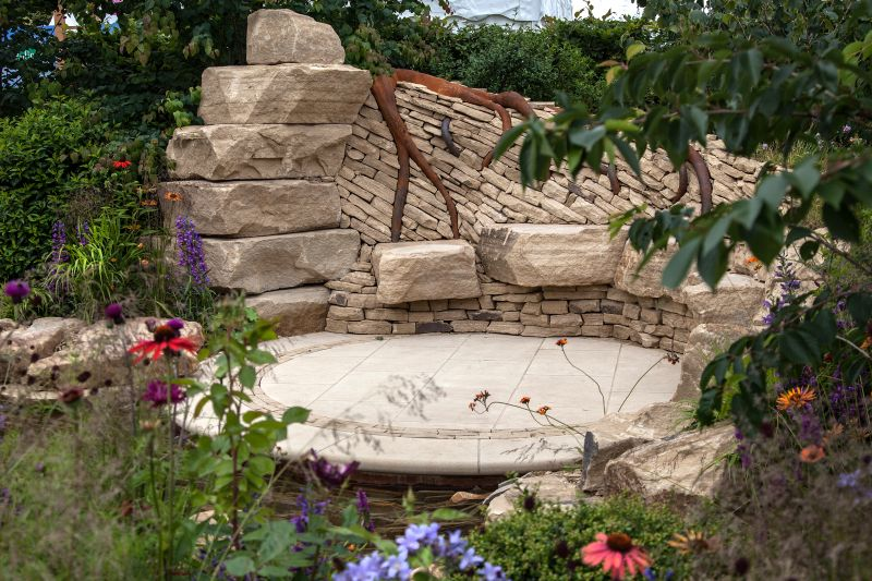 Backyard zoflora rocks seating