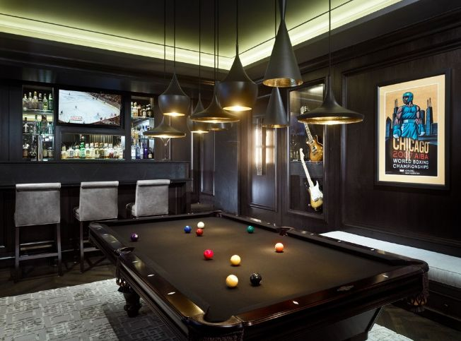 Billiard room with Tomdixon lighting above