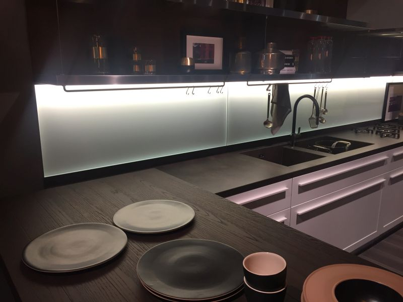 Black countertop and pink cabinets with led under cabinet lighting