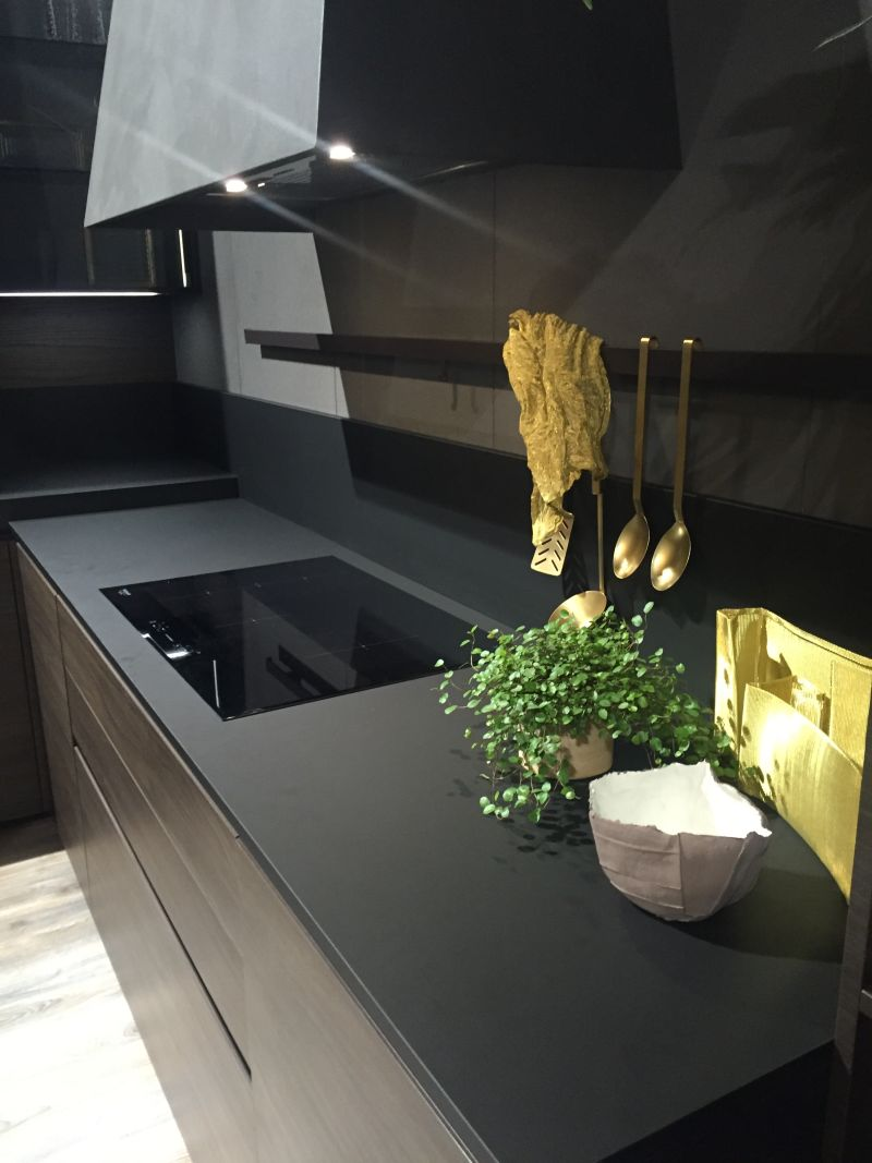 Black kitchen design with kitchen tools holder & Drama And Elegance Reflected In A Black Kitchen Countertop