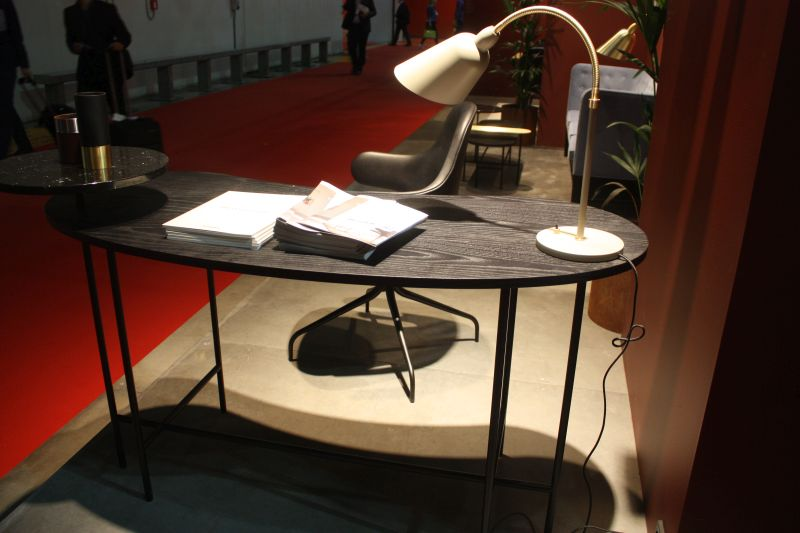 Black wire desk with a curved top