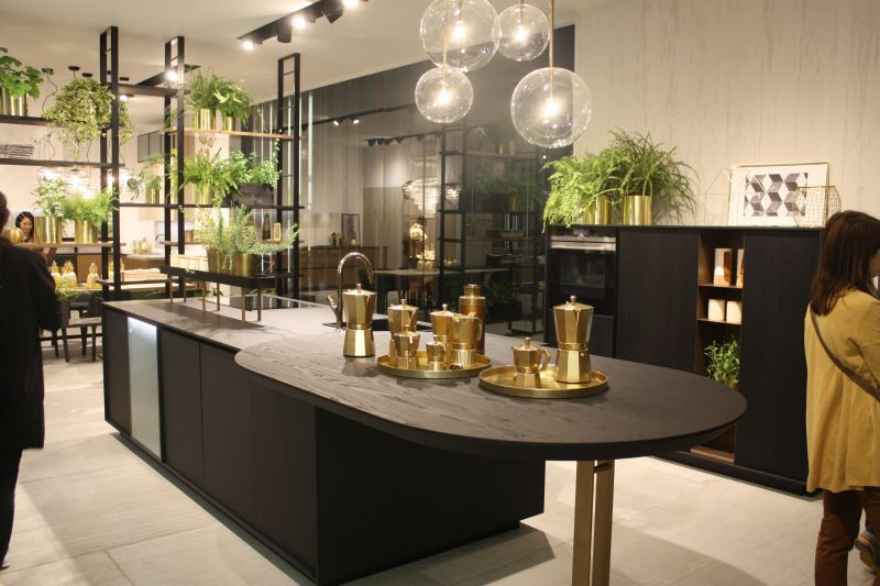 Black wood countertop with different gold pots