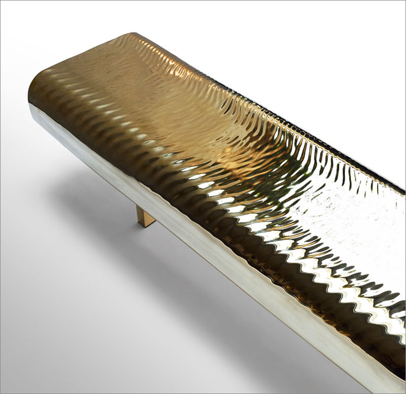 Brass Bench Is Covered In Golden Water-Like Ripples