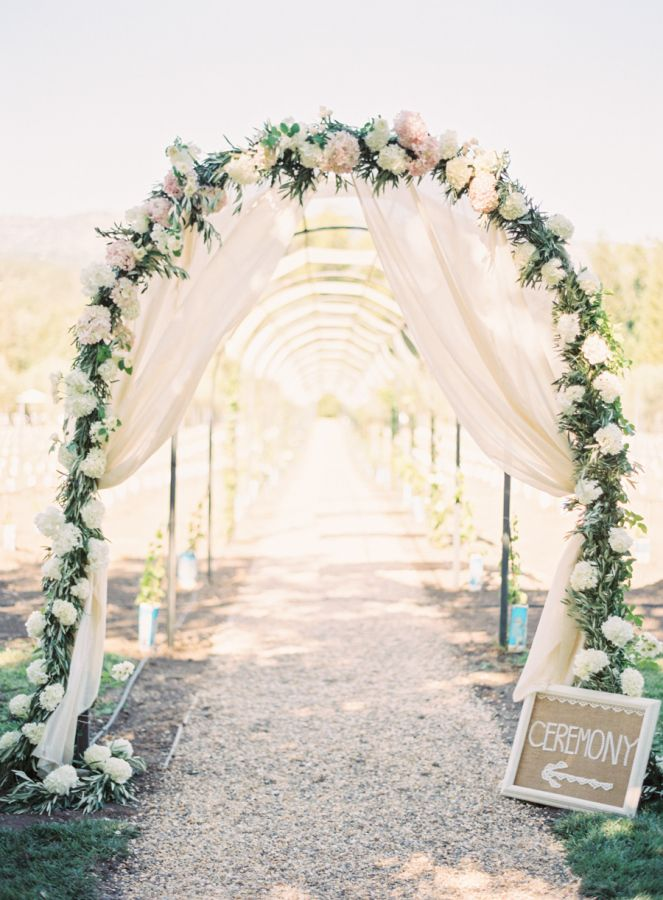 flowers for wedding arch bohemian wedding arches turn any space into a enclave 4269