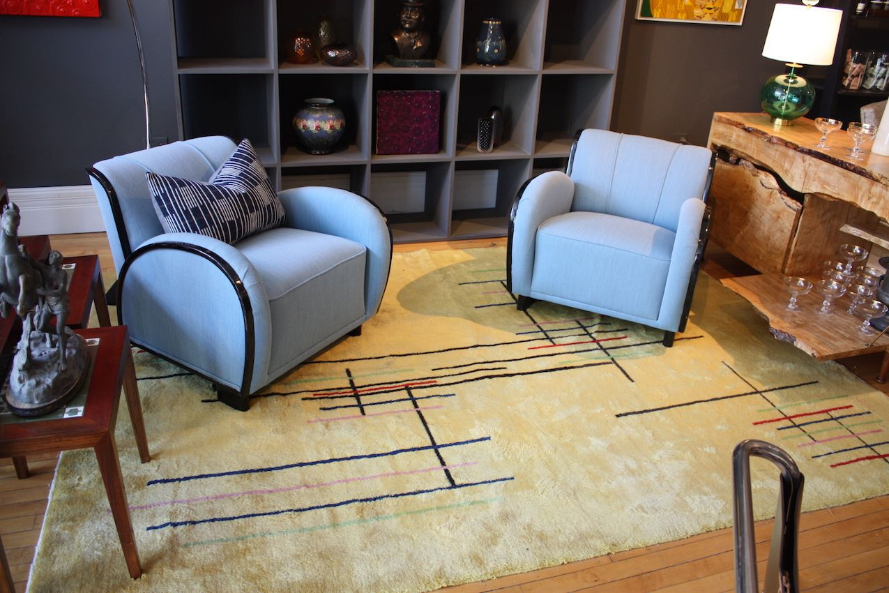 As soon as we walked into the shop, we were met by the stunning chairs. Something about their elegant shape and bright --but sophisticated -- shade of blue draws you in to the space. Paired with this graphic rug, they're perfect.
