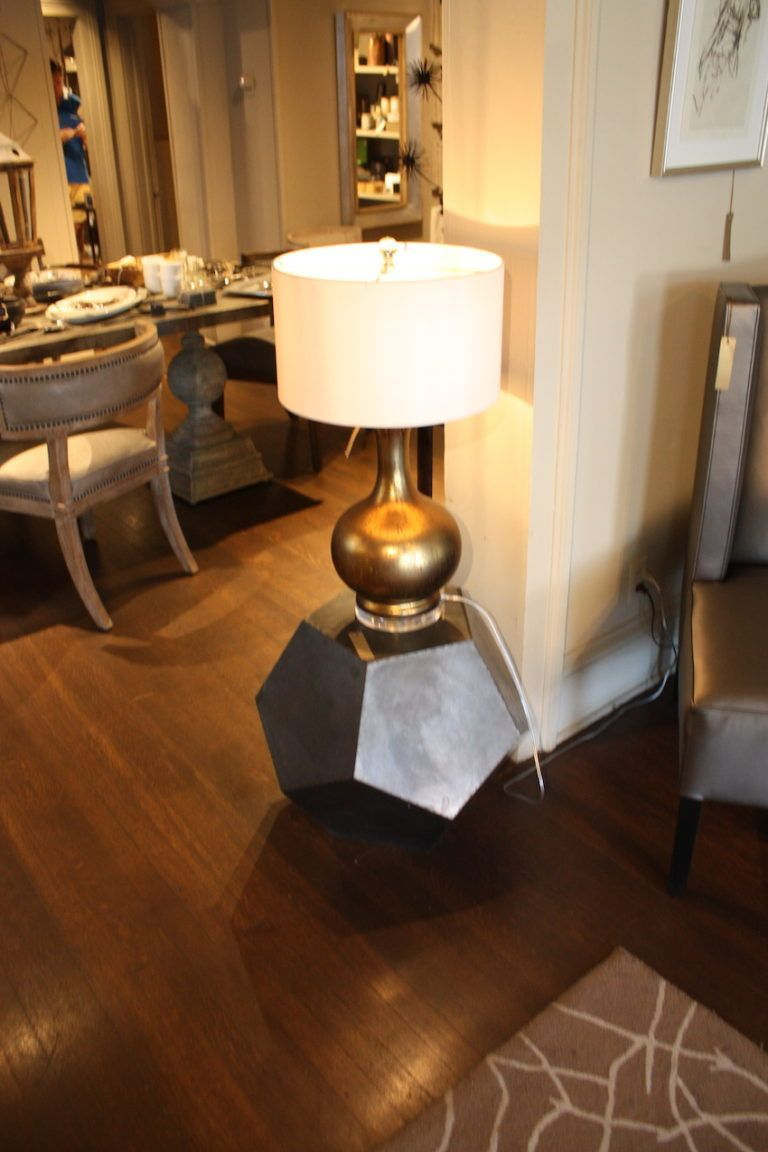 A classic lamp shape paired with a more unusual occasional table makes for an interesting combination.