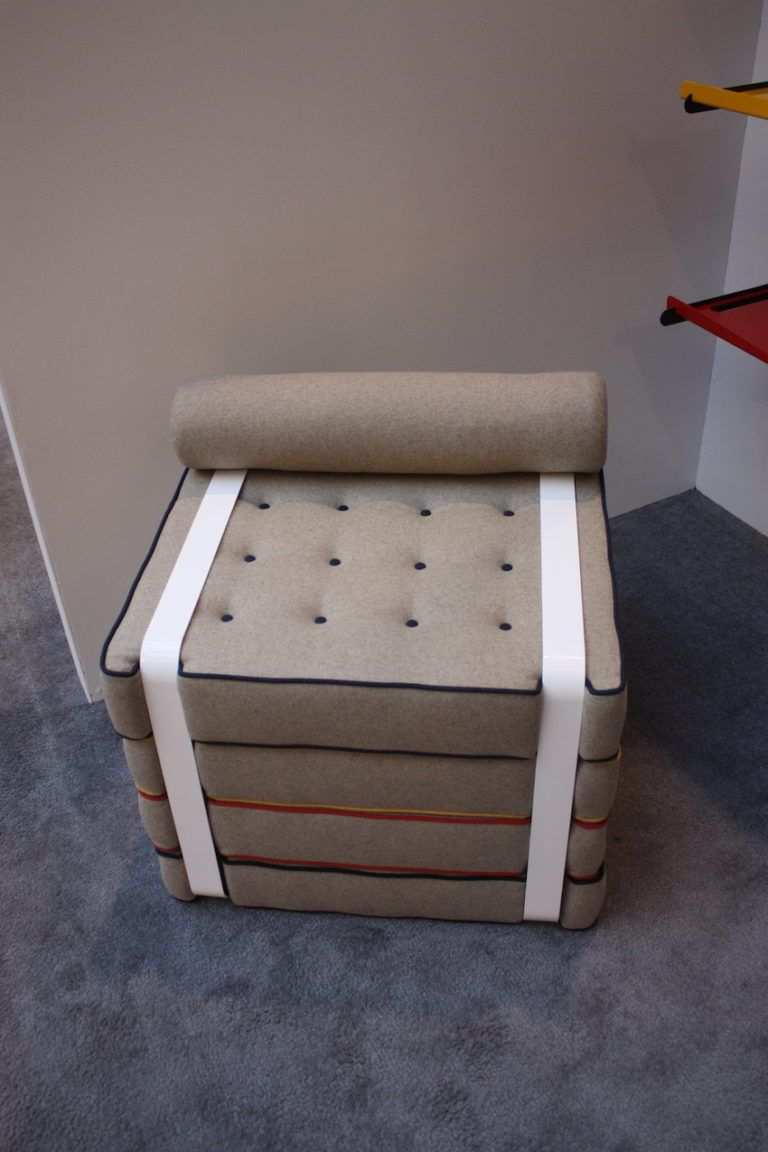 "Canadian industrial designer Khalil Jamal also has experience in public art and architectural products. This is his CLIP chair. ""Like a paper clip holds sheets of paper together, a bent aluminum frame grasps the four soft cushions that make up the Clip seat,"" explains his website. .Each cushion is five inches thick, and users can re-stack the cushions, separate them from the frame, or make a larger seating unit by pushing numerous Clip chairs together."