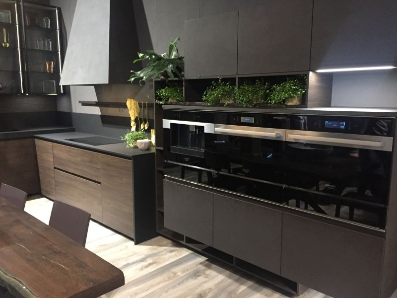 Dark brown cabinets with gray composit