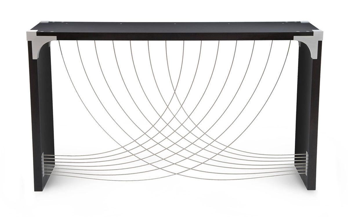 The Divergence table uses an exposed aluminum corner bracket. The sweeping curves of the cables evoke movement.
