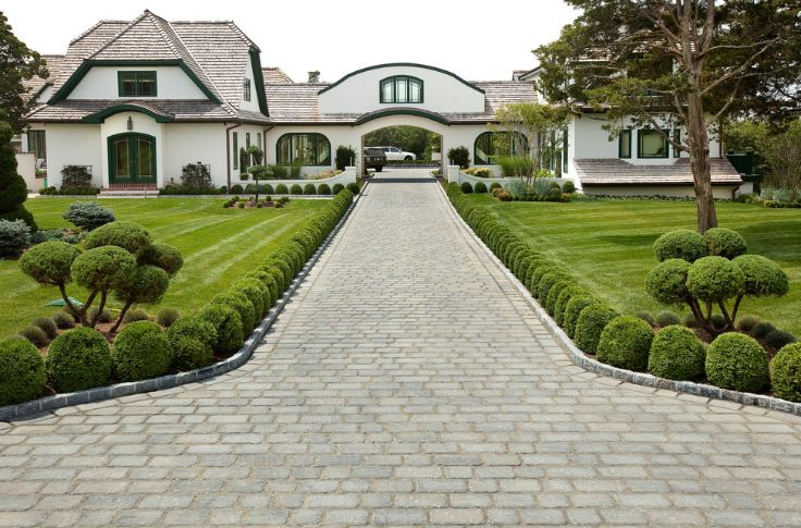 Add a green touch to your property with driveway pavers for Green pavers