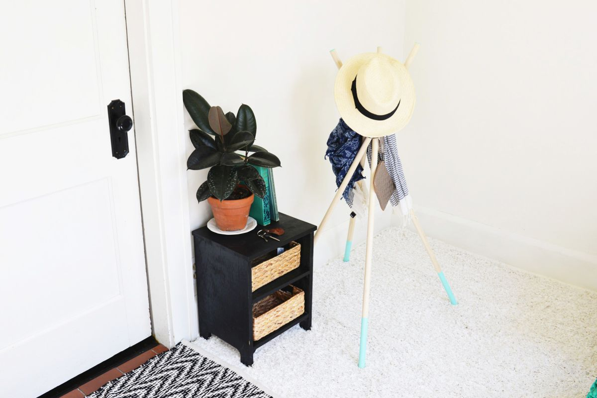 Entryway diy coat rack from wood sticks