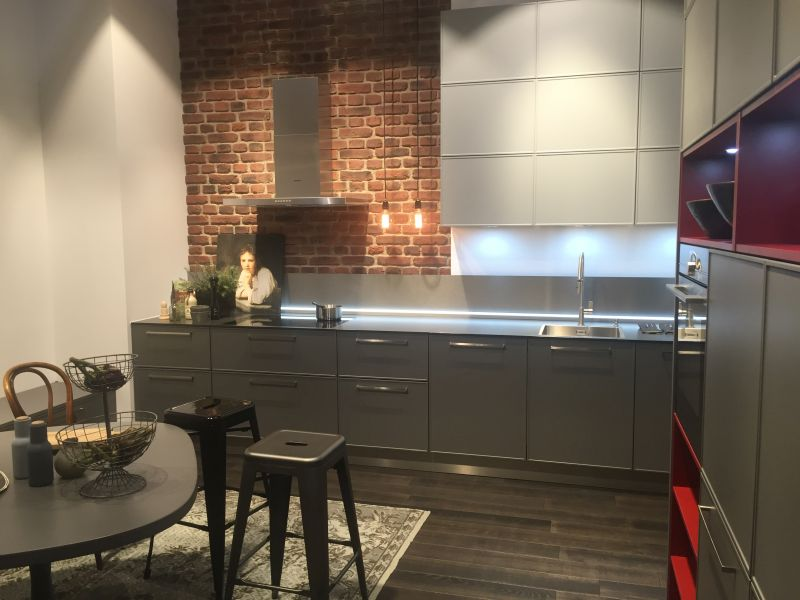 Exposed brick wall and edison cords hanging lamps with led under cabinet lighting