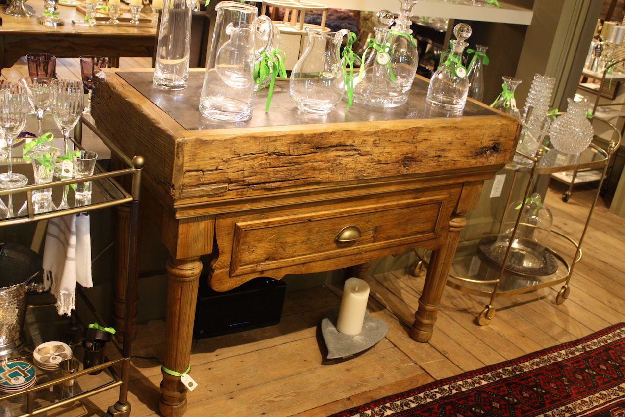 A weathered wood table serves as an unexpected base for glassware. Flanked by two tea carts, it's a substantial piece that would be great in a dining or living area. Speaking of tea carts, we love them for their versatility and design, and TK Home has a number of lovely designs. Used to display items, as a home base for serving coffee, or as a bar, a tea cart is a wonderful thing.