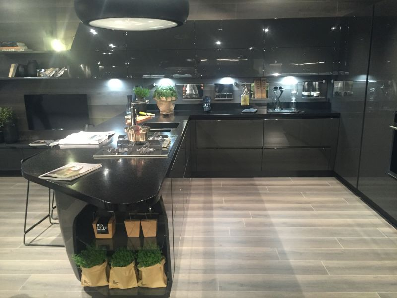 Full black kitchen design for a masculine bachelor loft with led under cabinet lighting