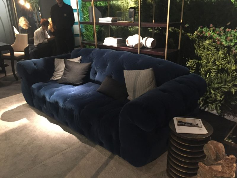 Generous tufted blue couch