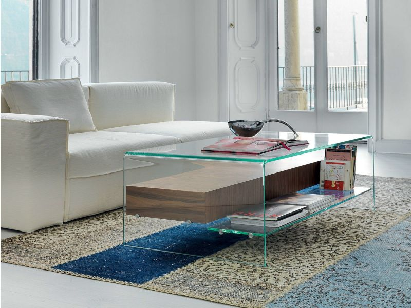 Glass coffee table with magazine storage