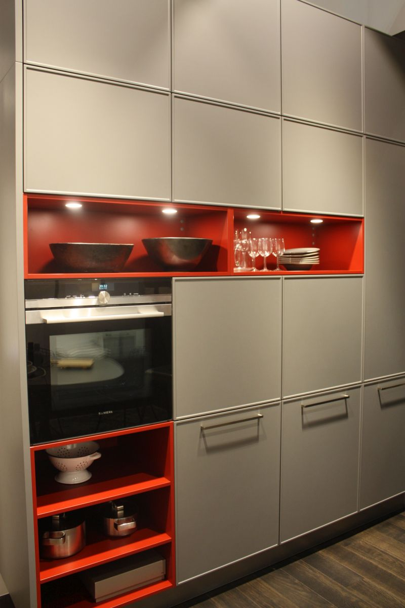 Gray shade mixed with orange and led under cabinet lighting for cubbies sotrage