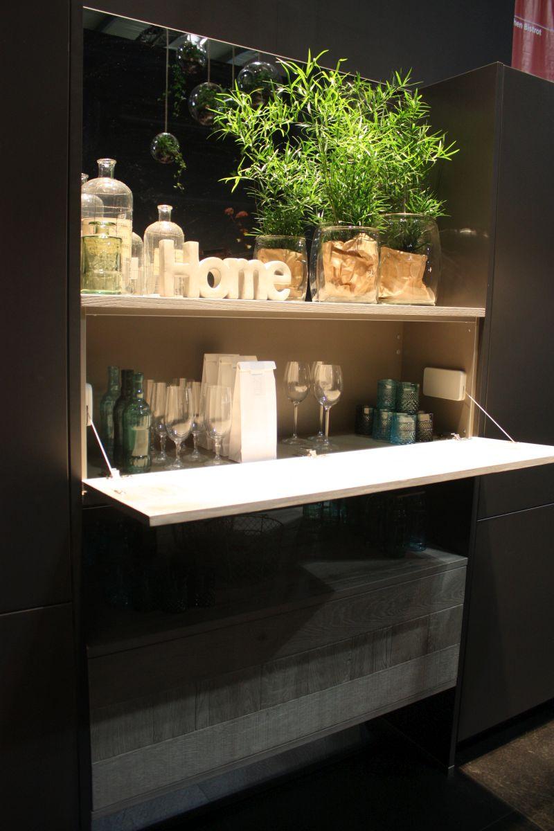 Hidden storage for bar accessories