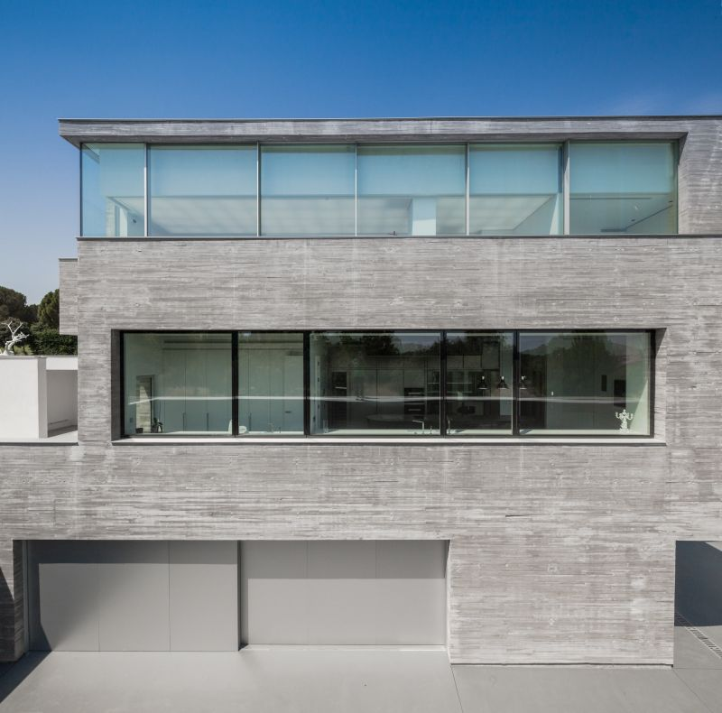 House H in Madrid exposed concrete facade for social areas