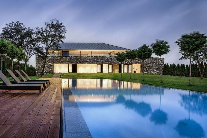 IO architects house with rocks facade and swimming pool