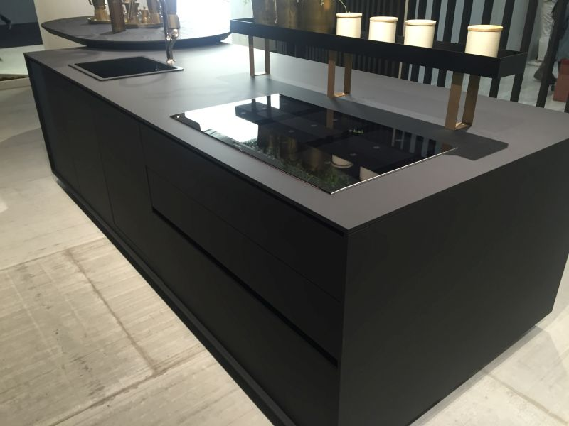 Large black kitchen island with brass accents