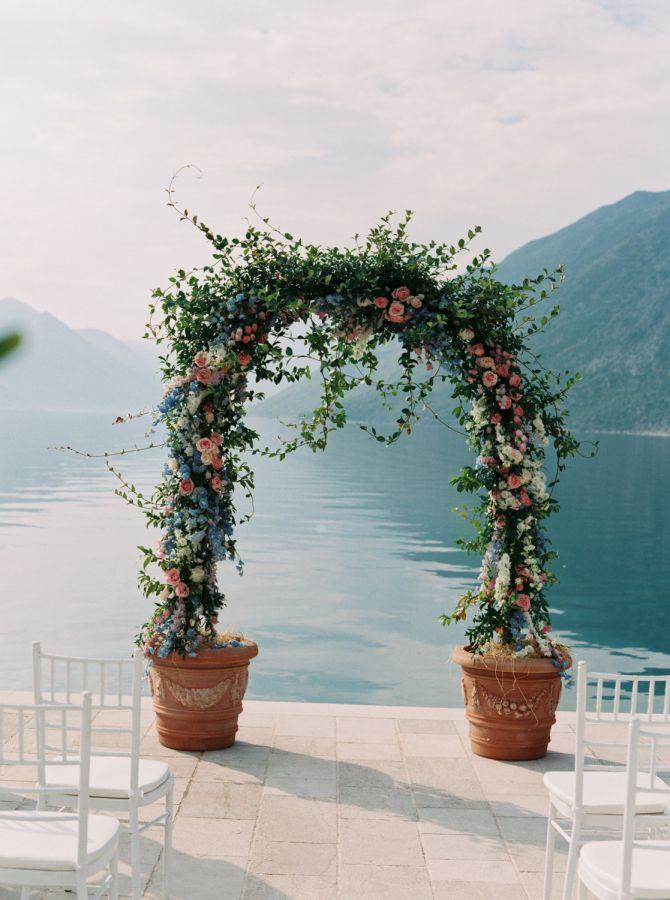 Large flower pots wedding arch