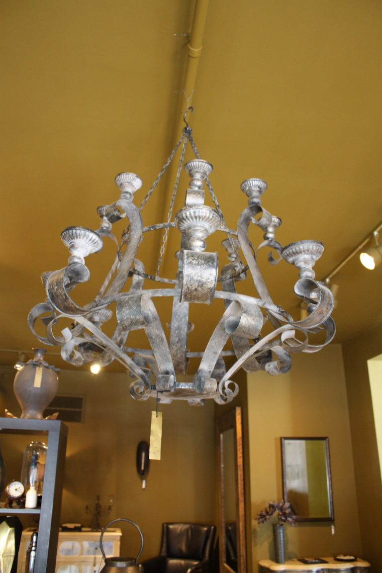 A bit medieval feeling, this substantial chandelier would be at home over a sturdy wood table or in an elegant country home foyer.