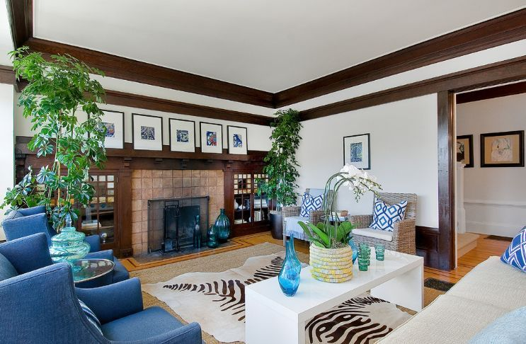 living room decorated with small and tall plants