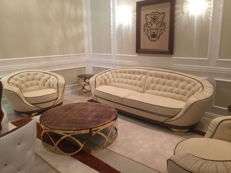 Luxury Cream Sofa And Armchair With A Tufted Design