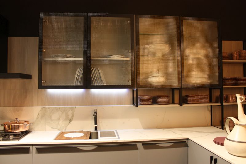 Marble kitchen with frosted glass for cabinet doors and led under cabinet lighting