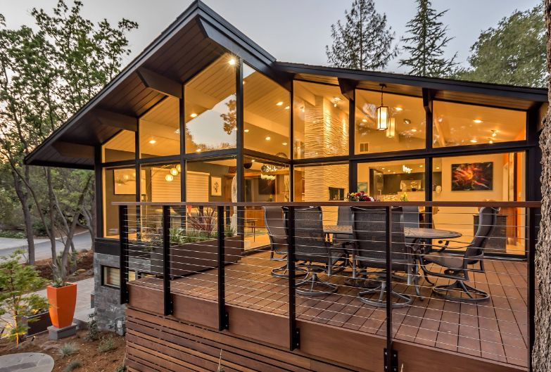 Mid century modern house with a large deck and railing design