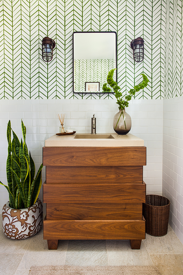 Modern bathroom vanity flanked with plants